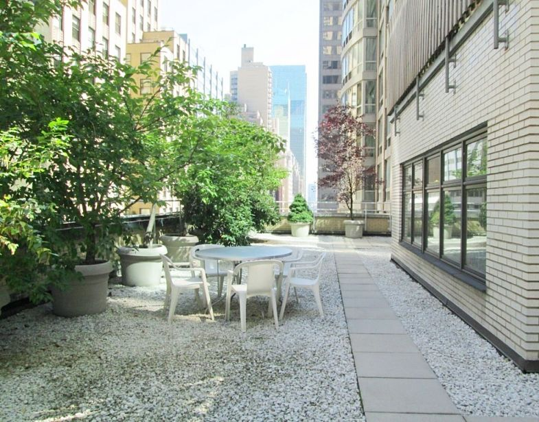 a new york city office with a table on the terrace