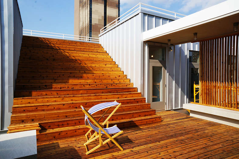 a rooftop with a wooden deck