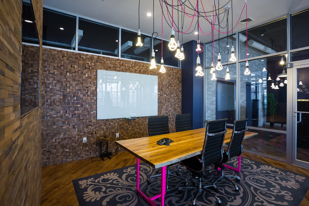 Breakout room with unique hanging bulbs
