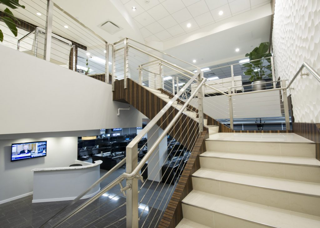a staircase leading to the second level of an office building